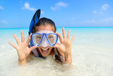 Beach vacation fun woman wearing a snorkel scuba mask making a goofy face while swimming in ocean water. Closeup portrait of Asian girl on her travel holidays. Summer or winter destination. - Fine Art prints