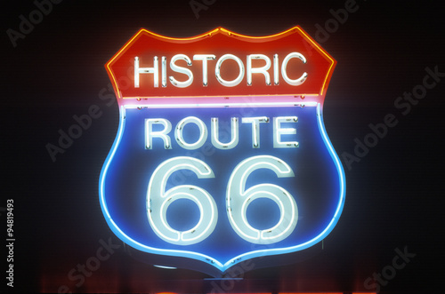 A neon sign that reads ÒHistoric Route 66Ó Poster