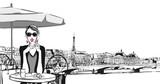 Young woman having breakfast in Paris