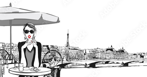 Young woman having breakfast in Paris © Isaxar