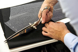 Tailor cutting fabric with shears