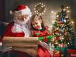 Obrazy na płótnie, fototapety, zdjęcia, fotoobrazy drukowane : Santa Claus and little girl