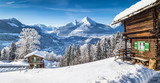 Fototapety Winter wonderland in the Alps with traditional mountain chalets