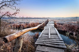 Fototapety Wooden bridge over river
