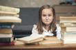 Постер, плакат: Школьница делает домашнюю работу