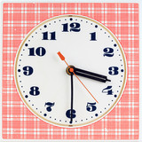 Round clock face on red striped background