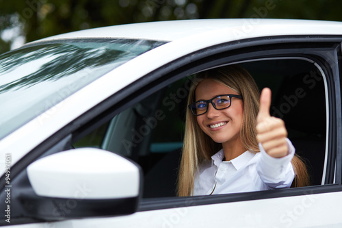 Fotografiet Woman makes gesture with thumb up