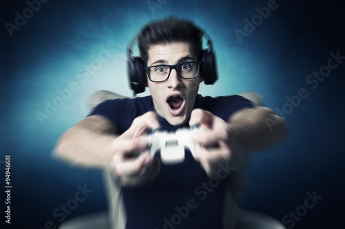videogame addicted young guy playing with console