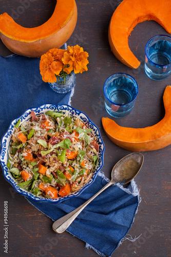 Salad with pumpkin,bacon , herbs , Parmesan cheese and pumpkin seeds.