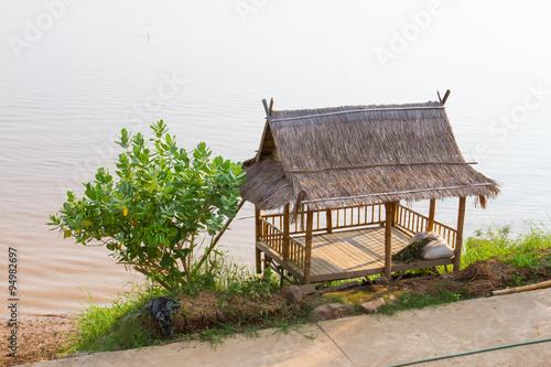 Poster Heuvel Small hut near river