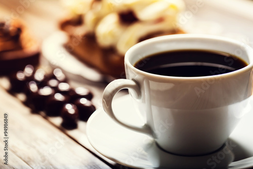 Poster Cup of coffee with assorted desserts
