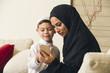 Arabian family, Arabian mother and son using mobile phone