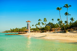 Fototapety Paradise tropical island in Dominican Republic. White sand, blue sea, clear sky and  lighthouse on shore