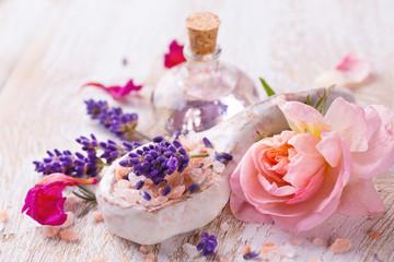 Spa still life with lavender, bathing salt, massage oil and rose flower