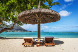 Fototapety Loungers and umbrella on tropical beach in Mauritius