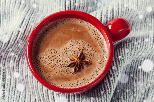 : Cup of hot cocoa or hot chocolate on knitted background with anise ...