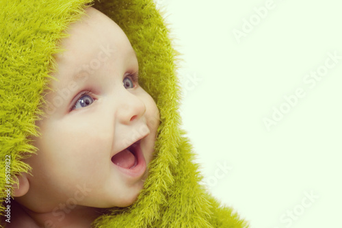 Happy Baby In Green Blanket