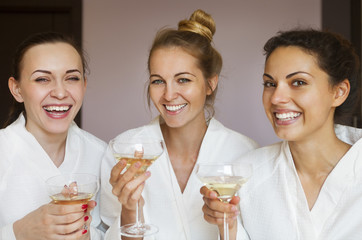 Young happy female friends drinking champagne in spa © Dasha Petrenko