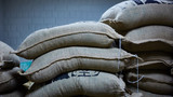 Fototapety stack of burlap sacks with coffee beans