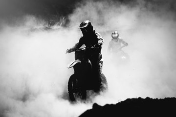 Motocross racer accelerating in dust track, Black and white, hig © Maksim Kostenko