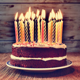 Fototapety birthday cake with some lit candles, filtered