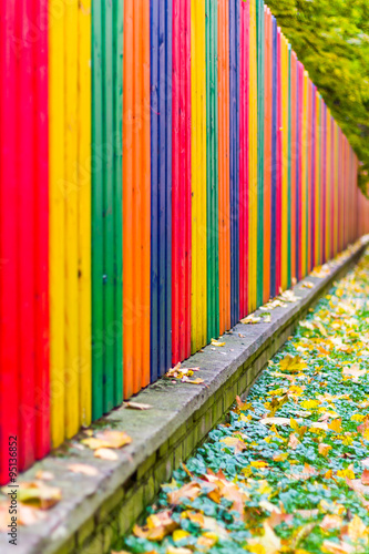 Quot multi colored rainbow wooden fence in autumn garden