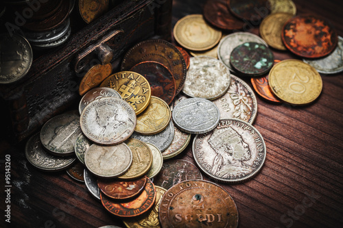 Poster old coins in chest