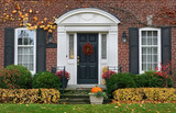 house front door in fall - 95147232