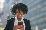 Fototapety Business woman in New York City texting cell phone