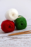 Knitting for Christmas with red, green and white yarn - 95184017