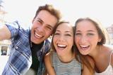 Fototapety Group of teen friends taking a selfie