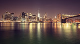 Vintage toned Manhattan waterfront at night, NYC, USA.