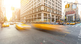 Busy road intersection in Manhattan, New York, at sunset - 95249632