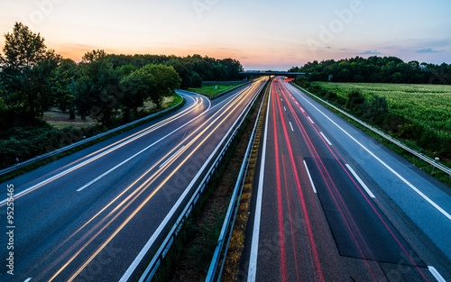 Sunset long-exposure over a german highway - 95255465