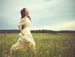 Beautiful woman in field - 95257840