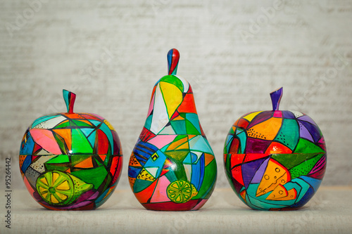 Plakat Wooden apples and pear painted by hand. Handmade, contemporary art.