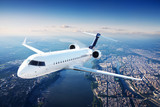Private jet plane in the blue sky - 95279020