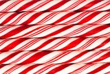 Full background of red and white striped Christmas candy canes