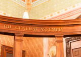 The General Assembly sign on wooden beam inside Illinois State C