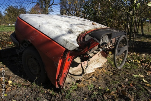 Foto op Canvas Snelle auto s Rusty vintage car cut in half on a sunny day in autumn