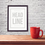 Fototapety Poster mock up template with red cup on wooden table over brick white wall
