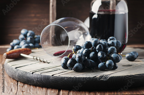 Fresh grape and red wine on the vintage table Poster
