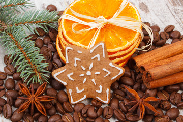 Decorated gingerbread, coffee grains and spices, christmas time