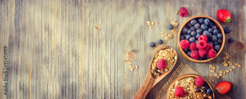 Fresh healthy breakfast with granola and berries, copy space rus
