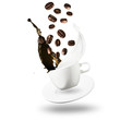 Coffee and Milk Splash From Falling Cup With Plate and Silver Spoon