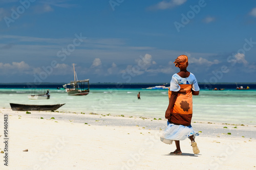 Poster Zanzibar Ethnic women on sandy beach, Africa