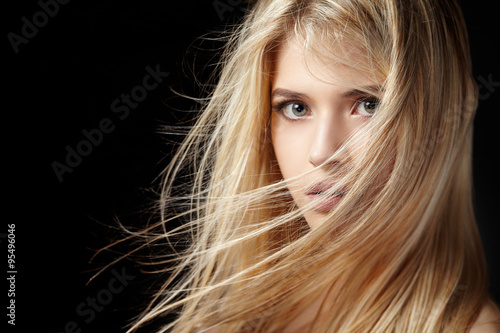 Poster Portrait of beautiful  blonde woman with flying hair.