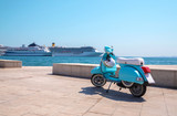 Blue scooter on the waterfront