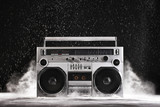 1980s Silver Retro ghetto blaster and dust isolated on black wit