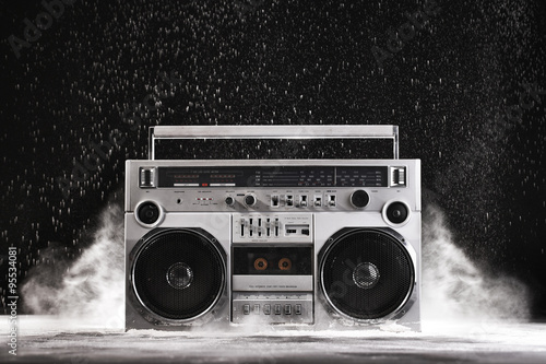 Poster 1980s Silver Retro ghetto blaster and dust isolated on black wit